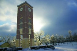 A wintery scene of the Smith-London Centennial Bell Tower as sunset approaches.