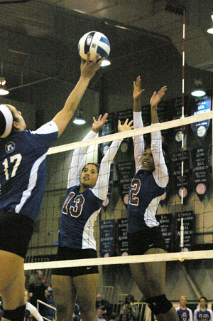 GRIZZIES NELLA IORAMO (No. 13) and Taylor Swayzer (No. 2) go up to block a shot by a John A. Logan College attacker during Friday's season home-opening match for Missouri State University-West Plains at the West Plains Civic Center.  The Grizzlies won the contest 25-9, 25-22, 19-25, 25-10.  (Missouri State-West Plains Photo)