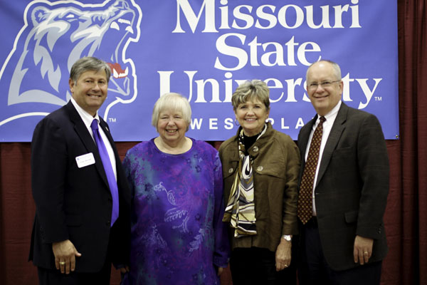 PLAQUES WERE PRESENTED to this year's Distinguished Alumni Award recipient Jenny Underwood, Thayer, and Distinguished Faculty/Staff Award recipient Kay Garrett, West Plains, during the annual Missouri State University Alumni Association's spring picnic for alumni and friends Thursday, May 1, at the West Plains Civic Center exhibit hall.  Over 280 attended the event, which gives area alumni and friends an opportunity to hear about the latest activities, events and accomplishments of the university.  The Distinguished Alumni Award recognizes a Missouri State University alumnus who has made extraordinary achievements in his or her personal and professional endeavors and has shown notable success in his or her profession or business, loyalty to the university and outstanding contributions to society.  The Distinguished Faculty/Staff Award recognizes extraordinary service among former employees of Missouri State-West Plains.  From left above are Missouri State-West Plains Chancellor Drew Bennett, Underwood, Garrett and Missouri State University System President Clif Smart.  (Missouri State-West Plains Photo)