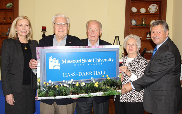 HASS-DARR HALL will be the name of post office building on Garfield Avenue following completion of renovation and expansion plans by Missouri State University-West Plains officials. The building's new name was unveiled today following the announcement of significant gifts from Mary Hass Sheid, West Plains, the William R. Hass family, Springfield, and William and Virginia Darr, Springfield, during a press conference at Kellett Hall. From left are Ms. Sheid, William R. Hass, William and Virginia Darr, and Missouri State-West Plains Chancellor Drew Bennett. (Missouri State-West Plains Photo)