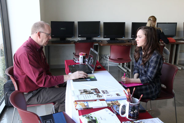 KATIE KAUFMAN, West Plains, visits with Missouri State University Teacher Certification Officer Scott Fiedler about the steps she needs to take to obtain her teaching credentials during Teacher Placement Day Feb. 26 at Gohn Hall on the Missouri State University-West Plains campus. The annual event, hosted by Missouri State's Teacher Education Completion Program on the West Plains campus and the Missouri State-West Plains Career Development Center, gives students who are in their final semester of an education program, as well as education program graduates, the opportunity to meet with administrators from school districts in south-central Missouri and north-central Arkansas and apply for open teaching positions in those districts. Organizers said 16 administrators representing 10 area school districts interviewed 28 teaching candidates, who represented education programs at Missouri State, Southwest Baptist University, Evangel University, Illinois State University and Haskell Indian Nations University. Organizers said the event was a success, pointing out administrators appreciated the personal interaction they were able to have with the candidates, and the candidates were happy with the exposure to local teaching opportunities and the chance to network with administrators. (Missouri State-West Plains Photo)