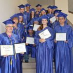 SOME OF THE STUDENTS graduating from the Adult Education and Literacy (AEL) high school equivalency program show their diplomas following graduation ceremonies July 20. (Photo provided)