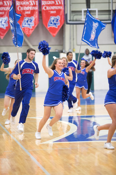 GRIZZLY CHEER TEAM members lead the basketball team onto the court at the 2017 homecoming game. (Missouri State-West Plains Photo)