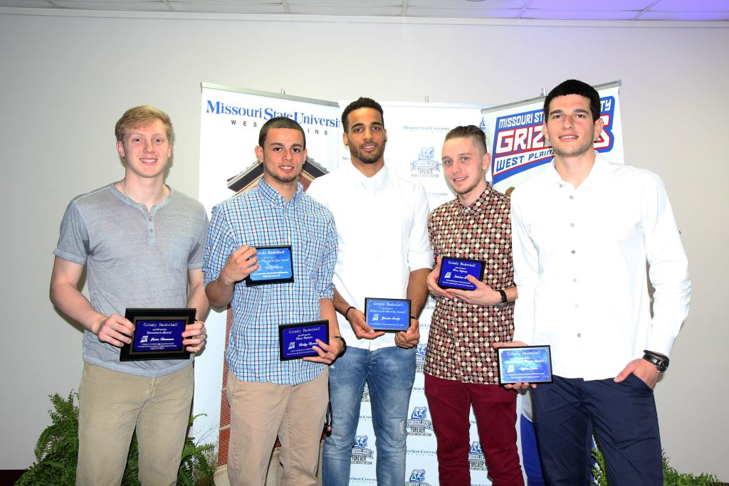 SEVERAL MEMBERS of the 2016-2017 Grizzly Basketball team at Missouri State University-West Plains received individual awards at the annual Grizzly Sports Reception Tuesday evening, April 11, at the West Plains Civic Center's Magnolia Room. From left, Lane Duncan, Licking, Uncommon Award (given to the player who displays exceptional character, work ethic and discipline); Ricky Torres, Pinellas Park, Fla., Defensive Player of the Year and Team Captain Awards; Yannis Mendy, Metting, France, Beast on the Boards Award (recognizes persistence on the glass); Quinton Gray, Ontario, Canada, Team Captain Award; and Stefan Lakic, Visegrad, Bosnia, Most Valuable Player Award. (Missouri State-West Plains Photo).
