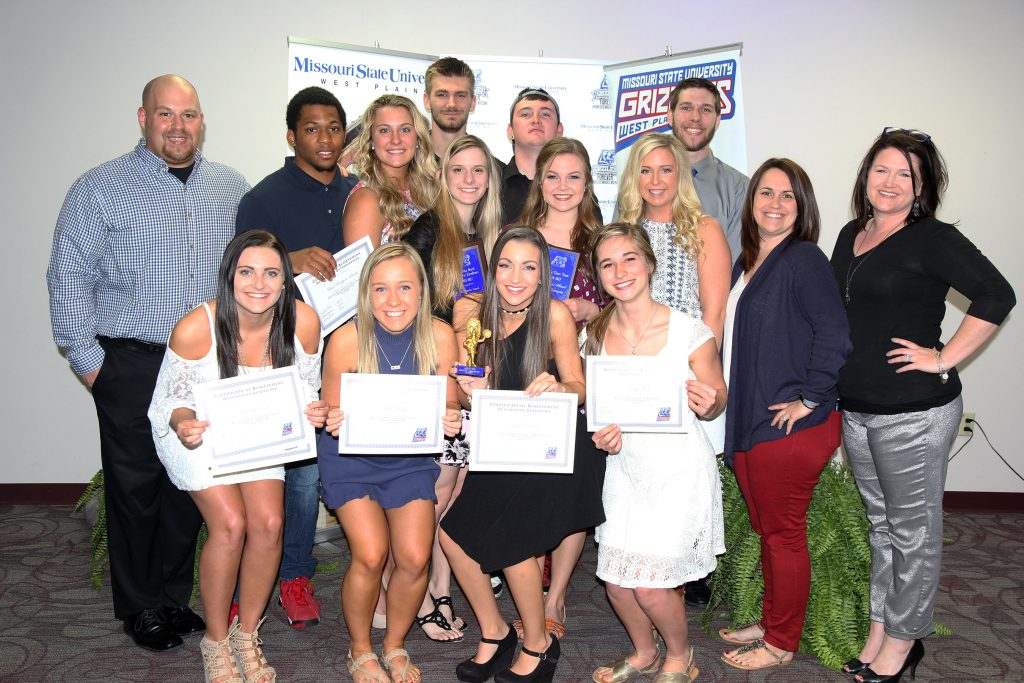 SEVERAL MEMBERS of the 2016-2017 Grizzly Cheer Team at Missouri State University-West Plains received individual awards at the annual Grizzly Sports Reception Tuesday evening, April 11, at the West Plains Civic Center's Magnolia Room. Front row from left, Makayla Koon, West Plains, Most Spirit and Outstanding Leadership Awards; Karli Habel, Spokane, Most Spirit Award; Jessie Dowler, Mountain View, Outstanding Leadership and Best Flyer Awards; and Maddy Wiehe, West Plains, Crowd Favorite Award. Second row: Head Coach Nick Pruitt; Chris Rodgers-Smith, St. Louis, Determination Award; Jerica Will, Winona, Determination Award; Mackenzie Lamb, Imperial, Samantha Beach Award for Excellence; Lindsey Thompson, Iberia, Academic Award; Meghan Ledford, Nixa, Most Improved Award; Assistant Coach Keena Simpson; and Cheer Team Coordinator Rachel Peterson. Back row: Colt Tompkins, West Plains, Best Base Award; Chris Berger, Conway; Grizz Appreciation Award; and Reece Totty, Beebe, Ark., Most Improved Award. (Missouri State-West Plains Photo).