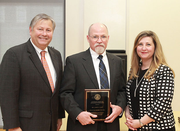 JAMES J. (JIM) HART, center, assistant professor of computer information systems/computer graphics and programming at Missouri State University-West Plains, received the Governor's Award for Excellence in Education during an April 5 luncheon in Jefferson City, Mo. With him are Missouri State-West Plains Chancellor Drew Bennett, left, and Missouri Associate Commissioner of Higher Education Zora Mulligan. (Photo provided)