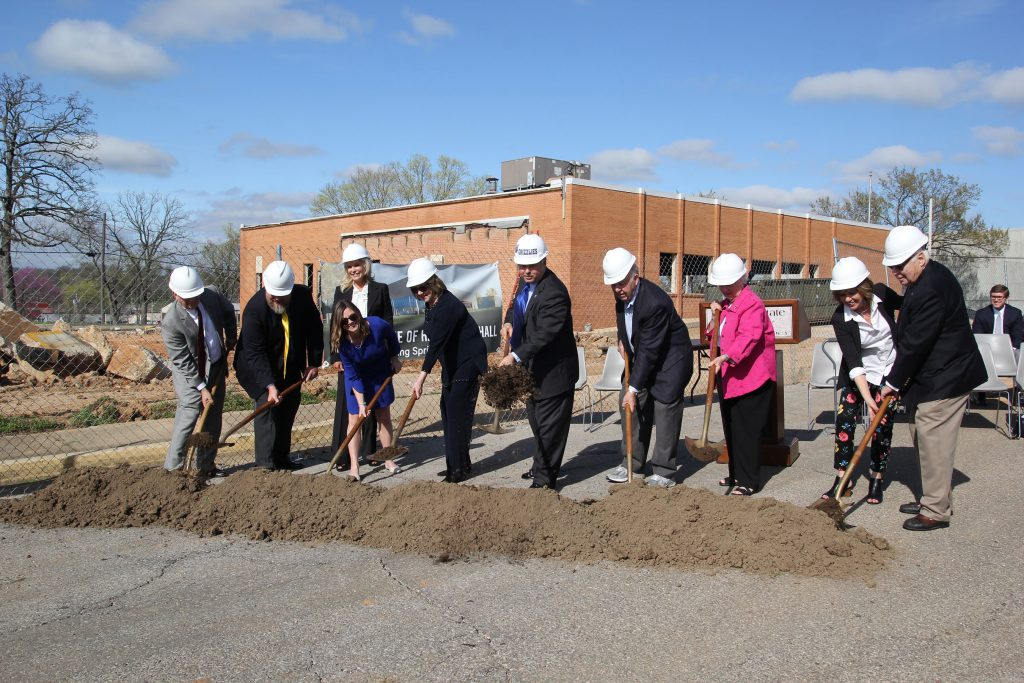"""WITH A TURN OF THE SHOVELS, Mary Hass Sheid and members of the extended Hass family, William and Virginia Darr of Springfield, and officials with Missouri State University-West Plains """"officially"""" broke ground Friday afternoon, March 31, on Hass-Darr Hall. Calling it """"a dream 20 years in the making,"""" Missouri State-West Plains Chancellor Drew Bennett said the facility will house the """"dreams and ambitions"""" of the campus' students. When completed in early 2018, the $4.1 million construction/renovation project at the site of the former West Plains Post Office on Garfield Avenue will provide a home for the Carol Silvey Student Union, the Drago College Store, William and Virginia Darr Honors Program, Veterans Center, admissions office, tutoring services and other much needed classroom and administrative office space that will enhance student learning and academic success. It is being financed with $1.5 million in state bonding funds; over $1.5 million in donations, including significant gifts from Mary Hass Sheid of West Plains, Judge William R. and Jeanne Hass of Springfield and formerly of Thayer, Judge William T. Hass of Thayer, and Tim and Missy Hass Myers of Bentonville, Arkansas, and the Darrs; and campus reserves. Speaking on behalf of the Hass family, Mary Hass Sheid called Missouri State-West Plains """"a tremendous campus"""" that is """"doing great things,"""" and William Darr added he and his wife were """"delighted"""" to be part of the project. Missouri State University System President Clif Smart said with the groundbreaking, three priorities for Missouri State-West Plains have been addressed – the additions of Gohn Hall and Hass-Darr Hall, and developing a state appropriations formula between the Springfield and West Plains campuses that has increased funding per student. With the shovels, from left, are Smart; Judge William T. Hass; Ashley Jeanne Casad, Baltimore, Md., daughter of Mary Hass Sheid; Mary Hass Sheid (behind Ashley Casad); Jeanne Hass; Bennett; William and Vi"""