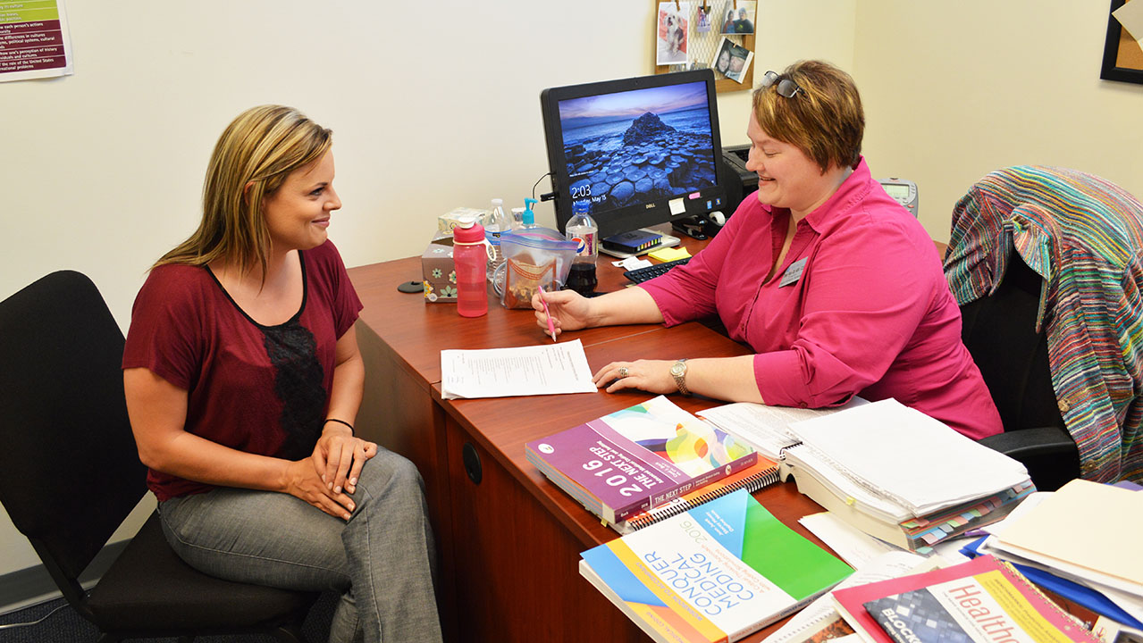 TIFFANY HALE, left, West Plains, discusses last-minute requirements to complete her Medical Coding Certificate from Missouri State University-West Plains with Tresa Ryan, instructor and director of the Associate of Applied Science in Health Information Technology degree program through which the certificate is offered. Hale completed her certificate in May and quickly found a job at Ozarks Medical Center. (Missouri State-West Plains Photo)