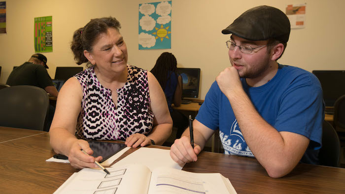 A student being tutored in the Grizzly Tutoring Lab.