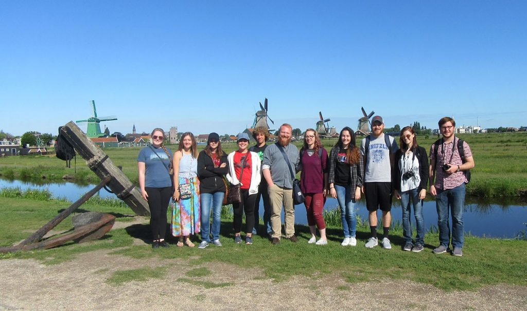 "MEMBERS OF THE DARR Honors Program at Missouri State University-West Plains posed for a group photo at the Zaanse Schans in the Netherlands during their short-term study away trip in May to Europe. The historical community serves as an ""outdoor museum"" to preserve the traditional windmills for which the country is known. They also visited Paris, France. From left are students Madison Knight, Salem; Blair Cook, Plato; Kaitlyn Jones, Nixa; Gretta Phillips, Winona; Weston Phipps, West Plains; Darr Honors Program Director Alex Pinnon and his wife, Trista; Rosemary Driscoll, Brandsville; Will Tillman, Thayer; Destiny Johnson, Bakersfield; and Brett Lair, West Plains. (Missouri State-West Plains Photo)"