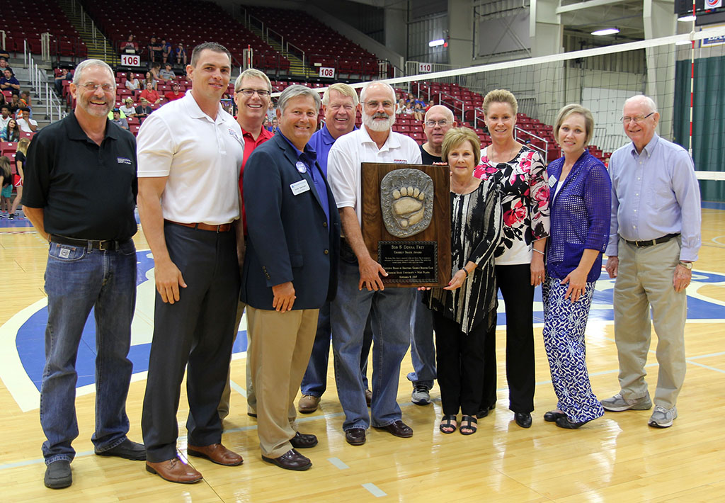 LOCAL RESIDENTS BOB AND DONNA FREY received the Grizzly Track Award from members of the Grizzly Booster Club Executive Board of Directors during the Sept. 8 Grizzly Volleyball team's season home opener at the West Plains Civic Center.  The award honors extraordinary support given by individuals or businesses on behalf of Grizzly Athletics. On hand for the award presentation were, front row from left, Grizzly Booster Club Executive Board member John Kenslow; Grizzly Basketball Head Coach Chris Popp; Missouri State-West Plains Chancellor Drew Bennett; Bob and Donna Frey; Grizzly Volleyball Head Coach Paula Wiedemann; Dean of Student Services/Athletic Director Dr. Angela Totty; and board member Ron Shemwell. Back row: Director of Development Joe Kammerer; acting board president Bo Pace; and board member Russ Squires. Donna Frey also is a member of the board. (Missouri State-West Plains Photo)