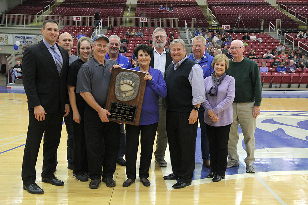LOCAL RESIDENTS DALE AND CAROLYN SMITH received the Grizzly Track Award from members of the Grizzly Booster Club Executive Board of Directors during the Nov. 21 Grizzly Basketball game at the West Plains Civic Center.  The award honors extraordinary support given by individuals or businesses on behalf of Grizzly Athletics. On hand for the award presentation were, front row from left, Grizzly Basketball Head Coach Chris Popp, Missouri State University-West PlainsDean of Student Services/Athletic Director Dr. Angela Totty, Dale and Carolyn Smith, Chancellor Drew Bennett, and Grizzly Booster Club Board Member Donna Frey. Back row: Grizzly Booster Club Board Members Russ Gant, John Kenslow and Steve DeClue, Acting Grizzly Booster Club Board President Bo Pace, and Grizzly Booster Club Board Member Ron Shemwell. (Missouri State-West Plains Photo)