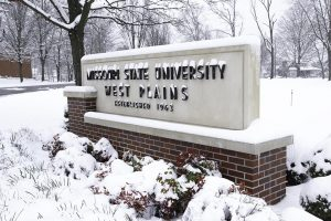 The Missouri State University-West Plains sign covered in snow