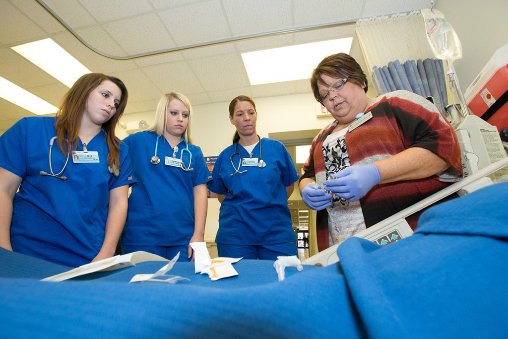 Nursing students learn how to prepare an IV.