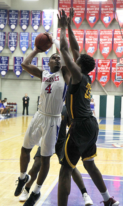 FRESHMAN GUARD ERIC LOVETT eyes the basket during Wednesday's game against Indian Hills. Lovett scored 13 points in the contest. (Missouri State-West Plains Photo)
