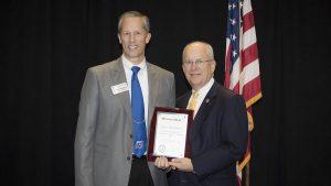 Scott Schneider receives Staff Excellence in Community Service Award