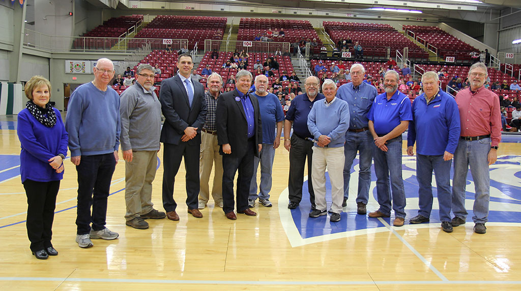 """FROM LEFT are Grizzly Booster Club board members Donna Frey, Ron Shemwell and John Williams; Grizzly Basketball Head Coach Chris Popp; booster club board member Chuck Kimberlin; Missouri State-West Plains Chancellor Drew Bennett; booster club board members Russ Squires and Bill Wood; Dr. M.O. """"Marv"""" Looney; former booster club board member and Board of Regents member Jerry Hall; and current booster club board members John Kenslow, Bo Pace and Steve DeClue. (Missouri State-West Plains photo)"""