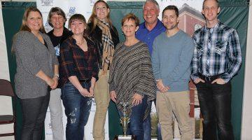 Team of university employees, friends win Trivia Night traveling trophy