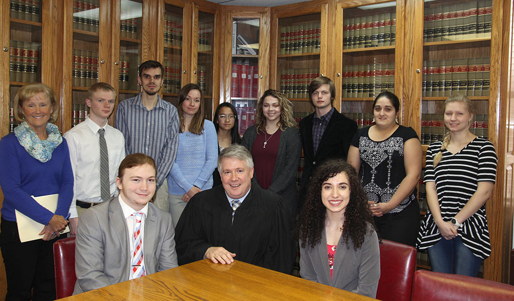 Seated from left are student Aaron Barton, West Plains; Judge Evans; and student Carlea Badolain, West Plains. Standing: Morrison and students Chris Harms, Alton; Michael Wright, Thayer; Alexis Barber and Annelis Muecke, West Plains; Emma Rector, Birch Tree; Sage Clunn, Ava; and Callie Scheck and Micky Hall, West Plains. (Missouri State-West Plains photo)