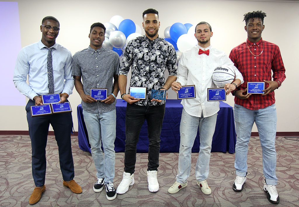 SEVERAL MEMBERS of the 2017-2018 Grizzly Basketball team at Missouri State University-West Plains received individual awards at the annual Grizzly Sports Reception Thursday evening, April 12, at the West Plains Civic Center's Magnolia Room. Ricky Torres, Pinellas Park, Fla., received the team-elected Most Valuable Player and Team Captain awards, as well as a commemorative basketball for setting new records in career assists (427), assists in a season (268) and assists in a game (16). Radshad Davis, Nassau, Bahamas, received the team-elected Most Valuable Player and Team Captain awards, as well as Defensive Player of the Year. Yannis Mendy, Paris, France, received the team-elected Team Captain award and the Uncommon Award for a determined effort to go above and beyond in all areas of his life. Montel Stewart, Palm Bay, Fla., received the Most Inspirational Award, and Dontell Brown, Lexington, Ky., received the Most Improved Award. From left are Davis, Stewart, Mendy, Torres and Brown. (Missouri State-West Plains Photo).