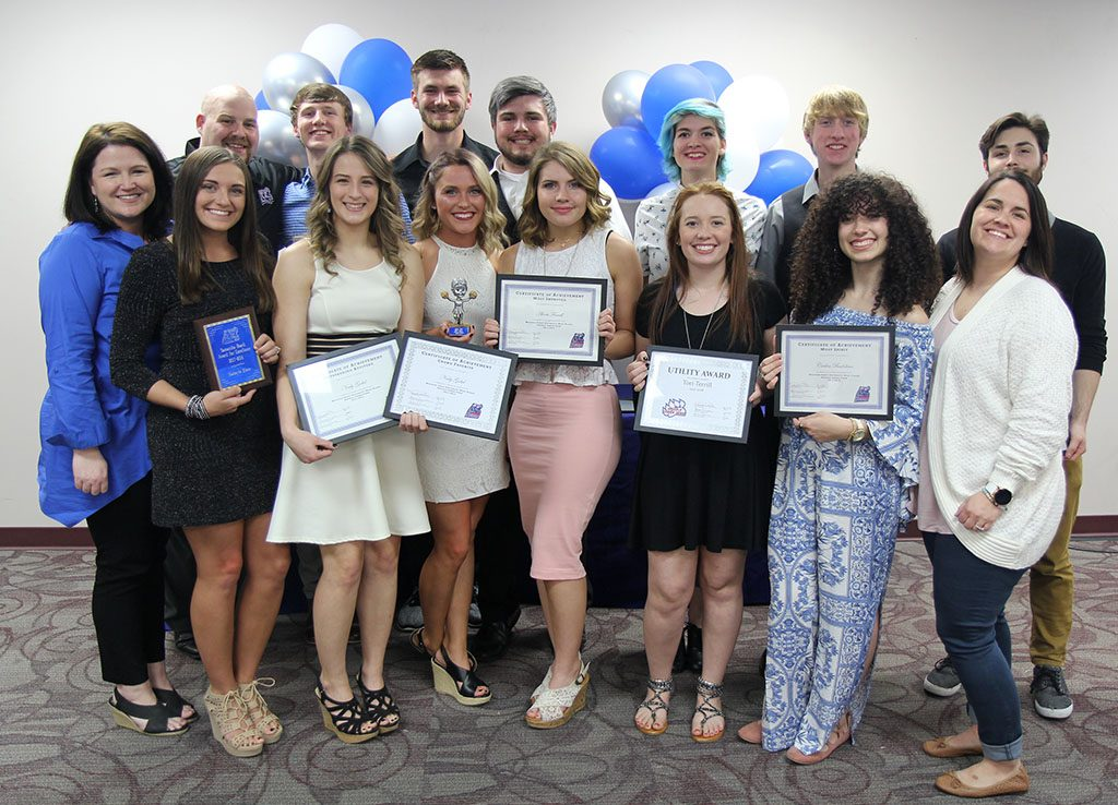 SEVERAL MEMBERS of the 2017-2018 Grizzly Cheer Team at Missouri State University-West Plains received individual awards at the annual Grizzly Sports Reception Thursday evening, April 12, at the West Plains Civic Center's Magnolia Room. Front row from left, Cheer Team Coordinator Rachel Peterson; Makayla Koon, West Plains, Samantha Beach Award for Excellence; Neely Gobel, West Plains, Outstanding Attitude and Crowd Favorite Awards; Felicity Snelling, Licking, Best Flyer; Alexis Fuwell, Mountain Grove, Most Improved Award; Tori Terrill, Mountain View, Utility Award; Carlea Badolian, West Plains, Most Spirit Award; Assistant Coach Keena Simpson. Back Row: Coach Nick Pruitt; Noah Mullican, Licking, Outstanding Attitude Award; Colt Tompkins, West Plains, Best Overall Cheerleader Award; Brandon Owens, West Plains, Best Base; Robyn Rex, Spokane, Grizz Appreciation Award; Zachary Cook, West Plains, Most Improved Award; Rylee Foreman, Plato, Determination and Academic Achievement Awards. (Missouri State-West Plains Photo).
