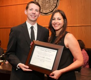 Ana Estrella-Riollano receives her award from Missouri State University Board of Governors member Kendall Seal, Kansas City, who served on the selection committee for the award. (Missouri State-West Plains Photo)