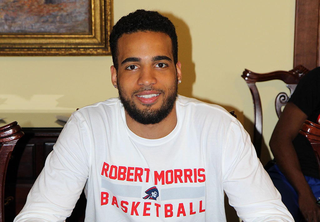 YANNIS MENDY, a 6-foot, 8-inch sophomore forward with the Missouri State University-West Plains Grizzly Basketball team, signed an official letter of intent today, May 4, to continue his collegiate basketball career at Robert Morris University near Pittsburg, Pennsylvania, this fall. (Missouri State-West Plains Photo)