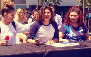 MONIKA LEON, center, signs her letter of intent with her twin sister, Tomasa, left, and her mother, Carolina, right, looking on. (Photo provided)