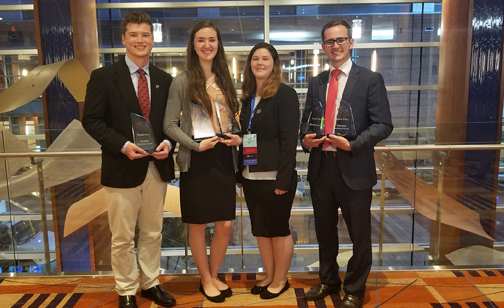 CURRENT MEMBERS and alumni of Missouri State University-West Plains' Phi Beta Lambda student business organization recently attended the PBL National Leadership Conference in Baltimore, Maryland. From left are alumnus Derek McGinnis, West Plains; current students Alyssa Dillon, Tecumseh, and Cynthia Peak, Willow Springs; and alumnus Dillon Cordel, West Plains. (Photo provided)
