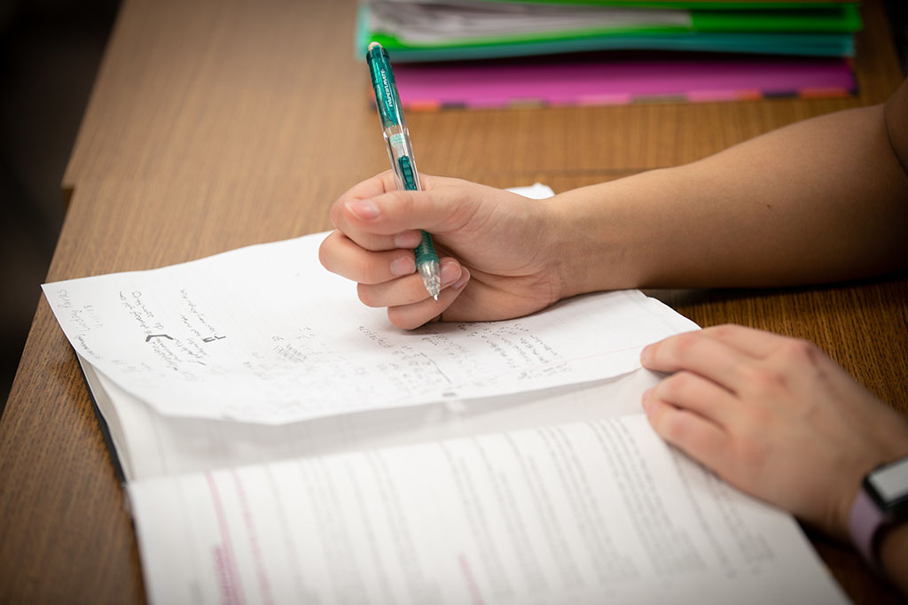 A student works on math problems in class.