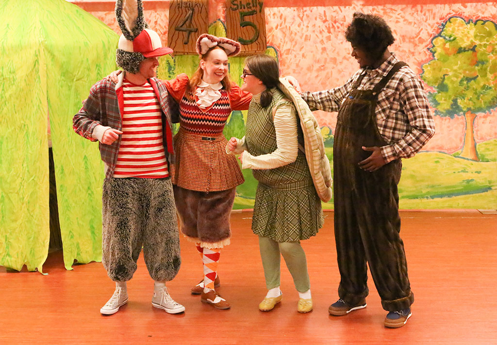 "Actors perform a scene from ""The Tortoise and the Hare."""