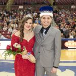 The queen and king stand at center court following their crowning.