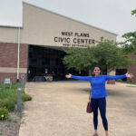 Patricia Figueiredo stands in front of the West Plains Civic Center entrance